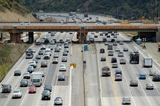 Traffic flows under the Mulholland Bridge on Interstate 405 which is slated to be demolished during the 11 miles shut down of Interstate 405 during the weekend of July 16-17 in Los Angeles, California.