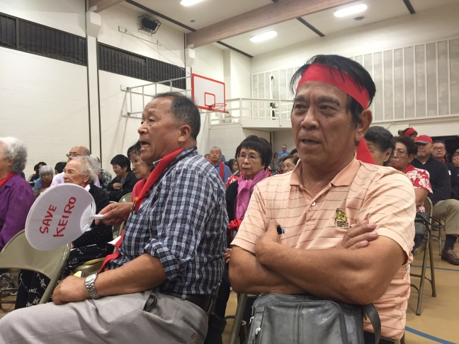More than 300 people turned out to oppose the Keiro sale, many wearing red bands in protest.