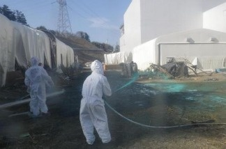 "A U.N. nuclear watchdog team said Monday Japan may need longer than the projected 40 years to decommission its tsunami-crippled nuclear plant and urged its operator to improve plant stability. The head of the International Atomic Energy Agency team, Juan Carlos Lentijo, said Monday that damage at the Fukushima Dai-ichi plant is so complex that it is ""impossible"" to predict how long the cleanup may last. (Workers at the Fukushima Dai-ichi nuclear power plant in March 2011.)"