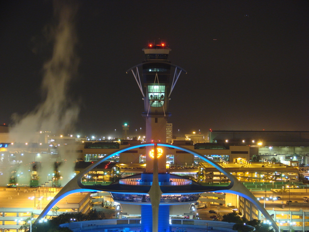 Long exposures + cold temps. The steam is from the airports powerplant. This photo is pre-renovation of the Encounter.