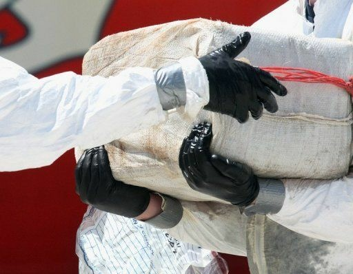 US Coast Guard crew members offload pounds of cocaine in Miami Beach, Florida, in 2011