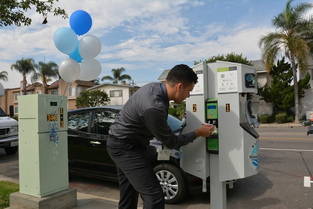 Sean Aquino, Burbank Water and Power customer service supervisor and Burbank resident, demonstrating the use of a charger.