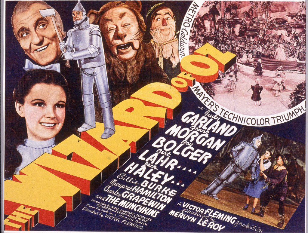 File: A lobby card from the film 'The Wizard Of Oz,' shows an illustration of American actress Judy Garland (1922 - 1969) (as Dorothy) and, left to right, actors Frank Morgan (1890 - 1949) (as the Wizard), Jack Haley (1898 - 1979) (as the Tin Man), Bert Lahr (1895 - 1967) (as the Cowardly Lion), and Ray Bolger (1904 - 1987) (as the Scarecrow), 1939. Several scenes from the film, which was directed by Victor Fleming, are also visible.