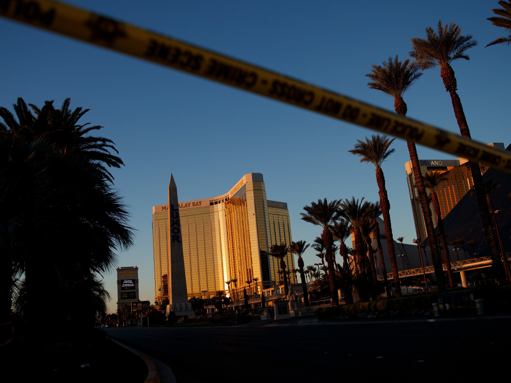 Police tape blocks off part of Las Vegas Blvd. on Tuesday near the scene of a massacre at a country music festival in Las Vegas. Twelve devices known as bump stocks were found in the gunman's room.