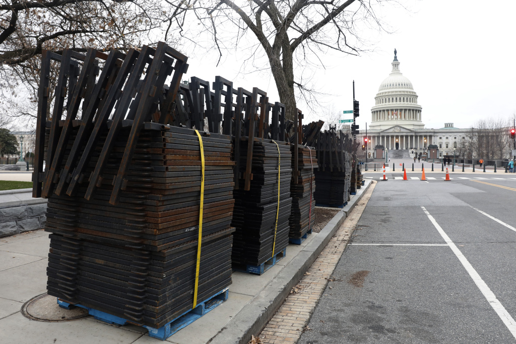Stacks of security fencing are seen near the US Capitol in preparation for the upcoming inauguration of President-elect Donald Trump January 16, 2017 in Washington, DC.