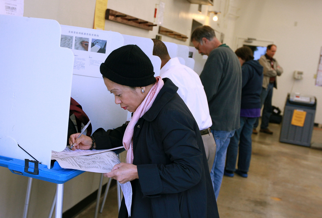 A voter fills out her ballot at a polling place at a fire station June 8, 2010 in Oakland, California. California voters are heading to the polls to vote in the primary elections for governor, U.S. senate and other statewide and local races.