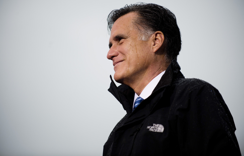 US Republican presidential candidate Mitt Romney speaks in the rain during a rally in Newport News, Virginia, on October 8, 2012.