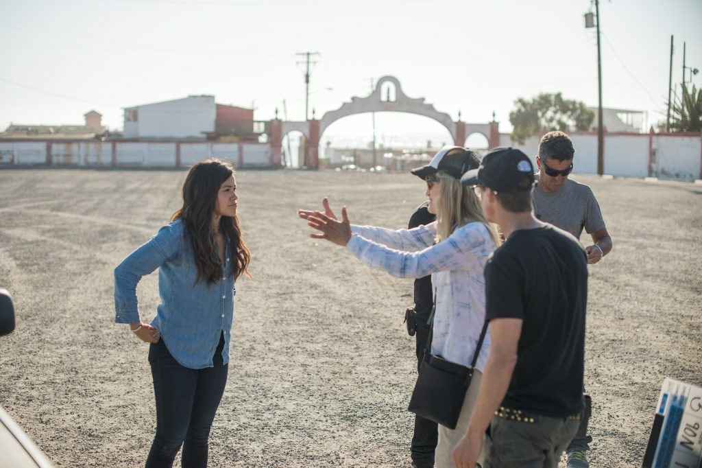 Director Catherine Hardwicke working through a scene with actress Gina Rodriguez (left) on the set of