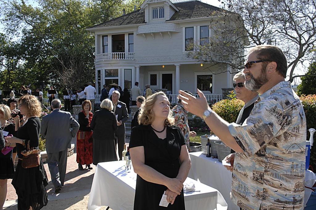 Orange County Supervisor John Moorlach chats at a reception.