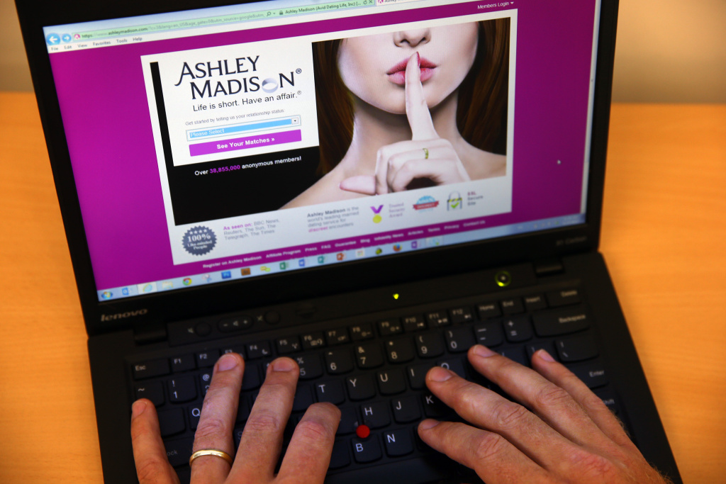 LONDON, ENGLAND - AUGUST 19:  In this photo illustration, a man visits the Ashley Madison website on August 19, 2015 in London, England. Hackers who stole customer information from the cheating site AshleyMadison.com dumped 9.7 gigabytes of data to the dark web on Tuesday fulfilling a threat to release sensitive information including account details, log-ins and credit card details, if Avid Life Media, the owner of the website didn't take Ashley Madison.com offline permanently. (Photo illustration by Carl Court/Getty Images)