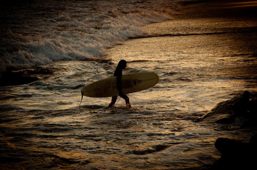 A surfer on Carpinteria State Beach.