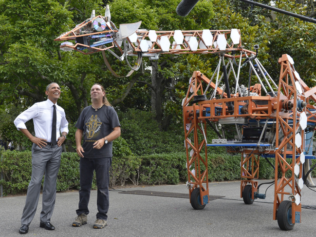 U.S. President Barack Obama (L) talks with Lindsay Lawlor of San Diego, California, the builder of a robotic giraffe at the White House Maker Faire projects on the South Lawn June 18, 2014 in Washington, DC. The Faire is a series of projects by students,  entrepreneurs and regular citizens using new technologies and tools to launch new businesses and learning new skills in science, technology, engineering and mathematics.