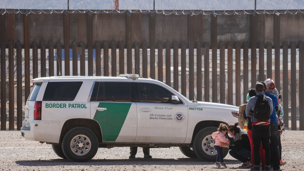 Border Patrol agents apprehend a group of migrants near downtown El Paso, Texas, on Monday. The Department of Homeland Security is struggling to manage a growing number of unaccompanied minors at the border.