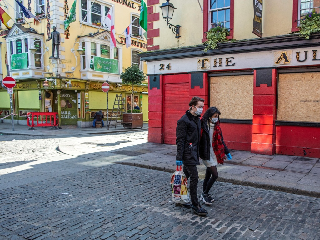 Bars, like this boarded-up pub in Dublin, closed in March. They can open their doors again in Phase Four of Ireland's reopening plan, which is newly delayed until  August.