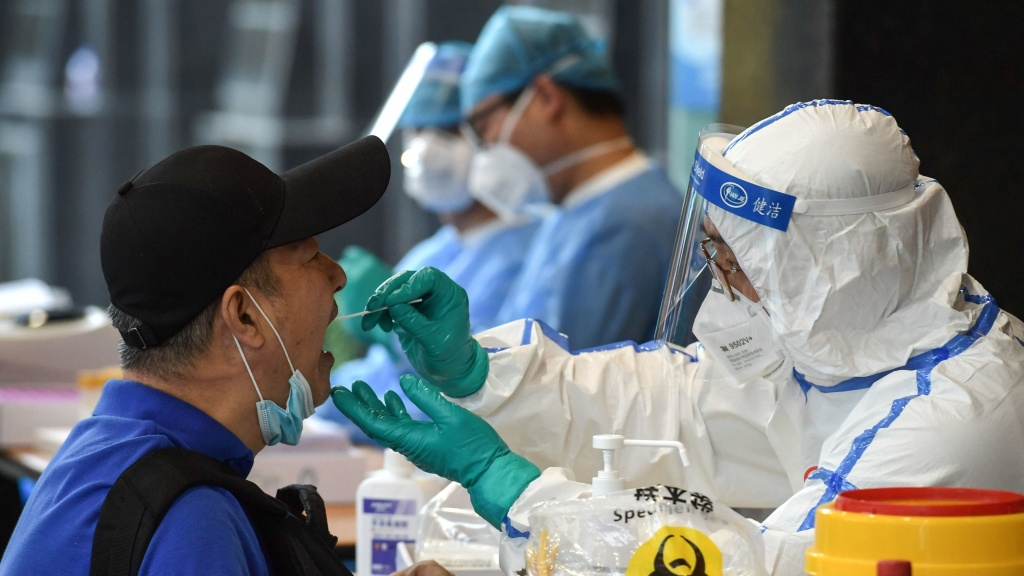 A man who visited Beijing recently is tested for the coronavirus in Nanjing in China's eastern Jiangsu province on Monday.