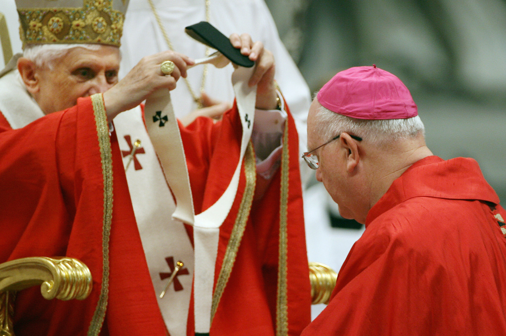 US Archbishop of San Francisco George Hugh Niederauer (R) receives the Pallum from Pope Benedict XVI in St. Peter's Basilica at the Vatican 29 June 2006, during a mass for the celebration of feast for the apostles Peter and Paul, patrons of the church.