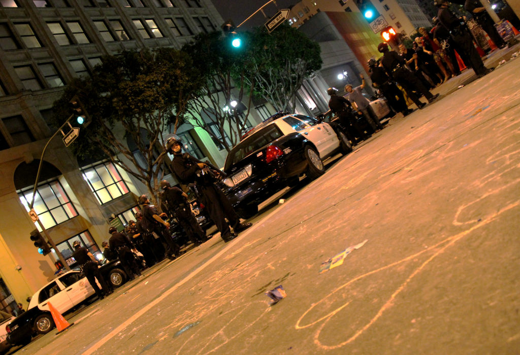 Los Angeles police officers and Occupy LA protesters clashed at ArtWalk, leading to 19 arrests and four injuries.