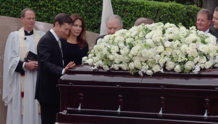 The son and daughter of Nancy Reagan, Ron Reagan and Patti Davis, pay their respects at their mother's casket during funeral services at the Reagan Library on March 11, 2016. The Rev. Stuart Kenworthy, vicar of Washington National Cathedral, officiated at the service.