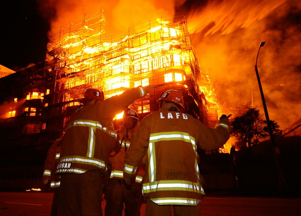 Firefighters in front of the massive Da Vinci building fire