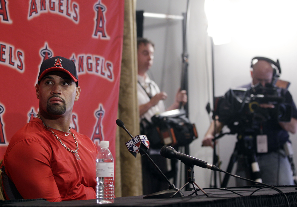Los Angeles Angels' Albert Pujols listens to a question during a news conference after a baseball spring training workout Monday, Feb. 20, 2012, in Tempe, Ariz.