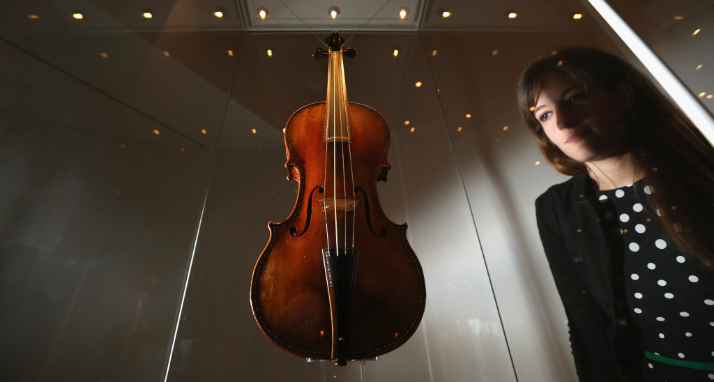 A woman views 'The Cipriani Potter' violin made by Antonio Stradivari in 1683 on display in the exhibition 'Stradivarius' at the Ashmolean museum on June 12, 2013 in Oxford, England. Eight Stradivarius violins have been brought together for