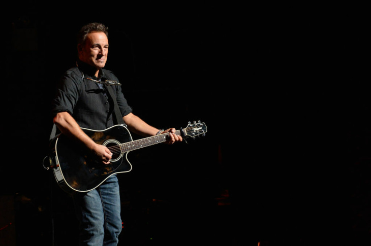 Jon Stewart at The Beacon Theatre on October 13, 2012 in New York City.  (Photo by Dimitrios Kambouris/Getty Images)   Bruce Springsteen at Madison Square Garden on December 12, 2012 in New York . (DON EMMERT/AFP/Getty Images)