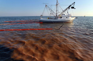 A shrimp boat passes through a heavy oil slick as it uses the deployed oil boom and absorption pads to collect the oil from the massive spill on May 5, 2010 in Breton and Chandeleur sounds off the coast of Louisiana. Oil is still leaking out of the Deepwater Horizon wellhead at a estimated rate of 1,000-5,000 barrels a day.