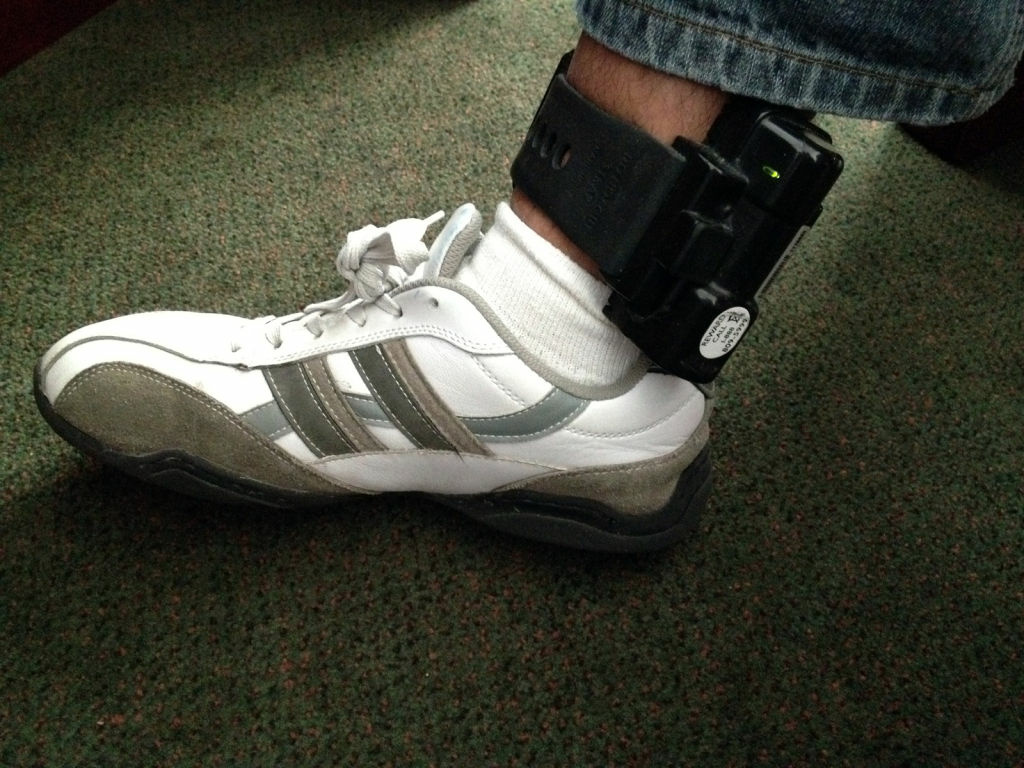 Oscar Carrillo wearing his ankle monitoring bracelet, April 6, 2012. The Los Angeles Times reports that Los Angeles County probation officers routinely ignore or even delete messages from these monitors because there are so many.