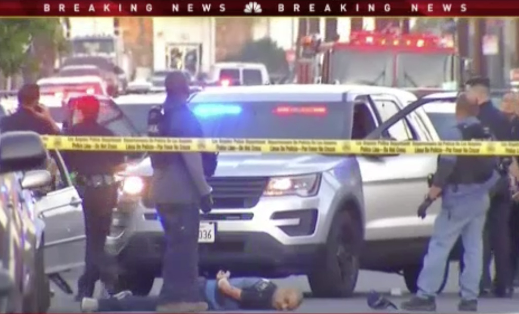 A robbery suspect was shot and killed by Los Angeles police after leading officers on a short pursuit in North Hollywood.