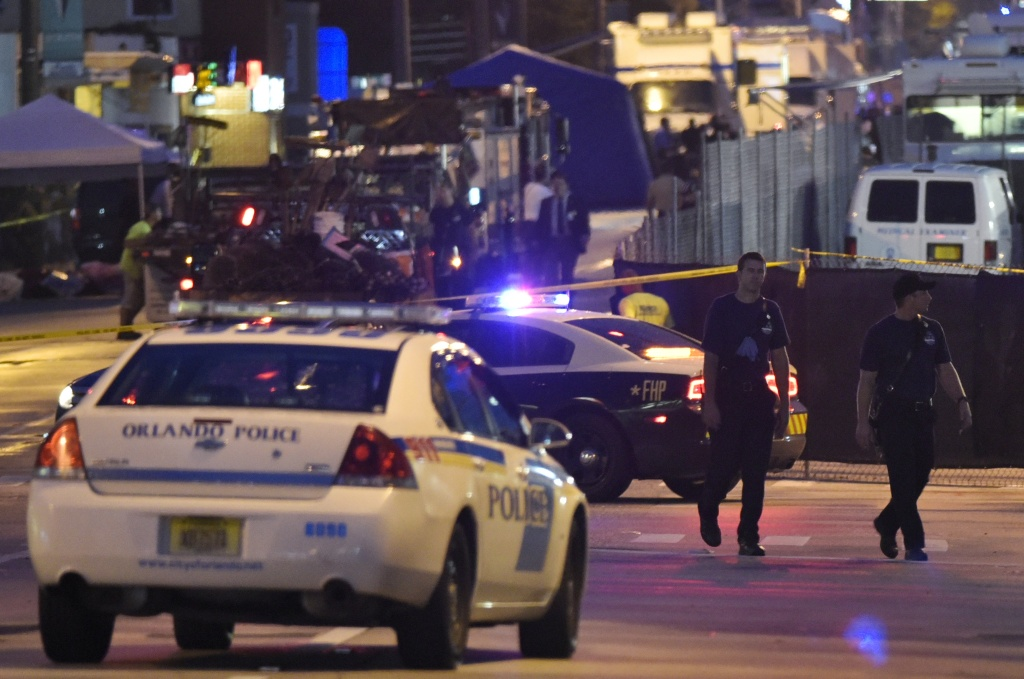 Lights from police vehicles light up the scene infront of the Pulse club in Orlando, Florida on June 12, 2016.