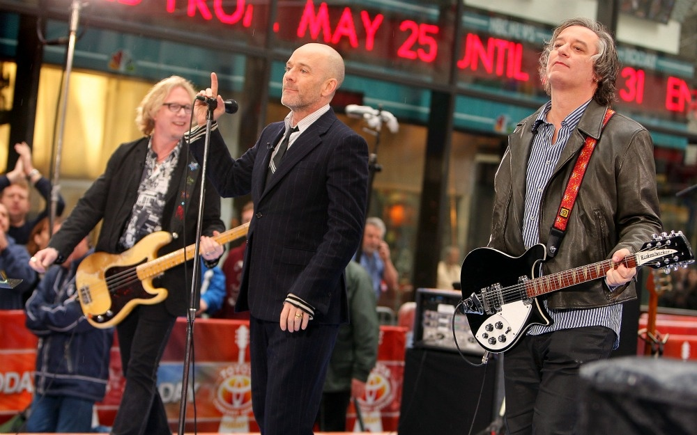 Mike Mills, Michael Stipe, and Peter Buck of R.E.M. perform during the NBC 'Today' show concert series at Rockefeller Center on April 1, 2008 in New York City.