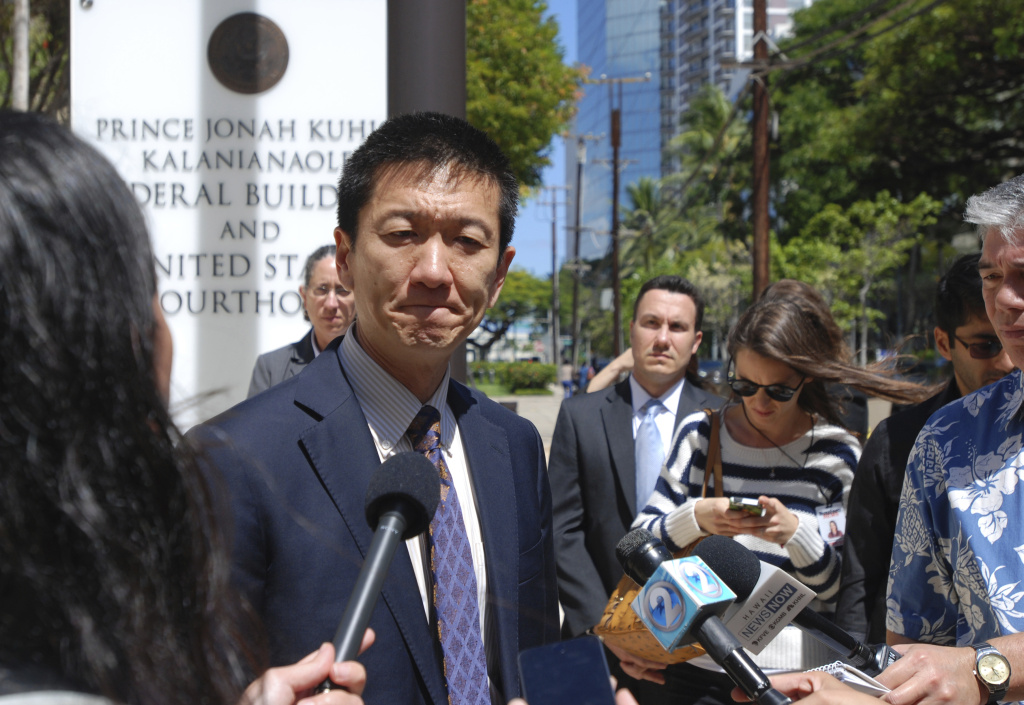 Hawaii Attorney General Douglas Chin speaks outside federal court in Honolulu on March 29, 2017 after a federal judge extended his order blocking President Donald Trump's travel ban.