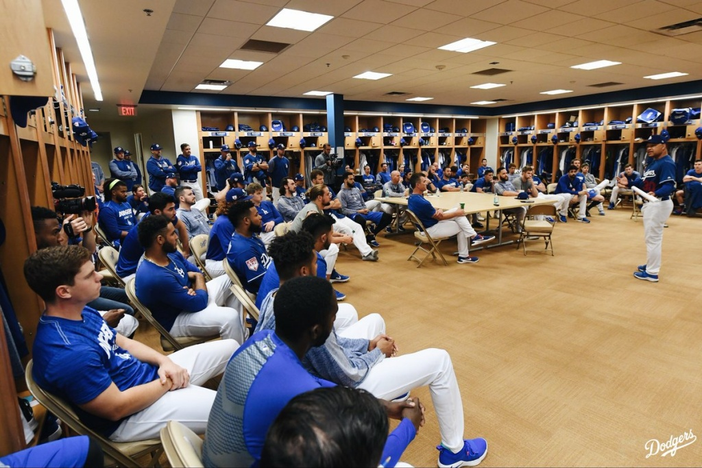 Dodgers manager Dave Roberts, speaks to players in their locker room during spring training