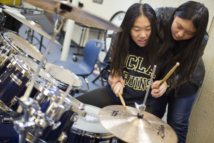 Sophomore Morgan Wang, center, takes part in a rehearsal of