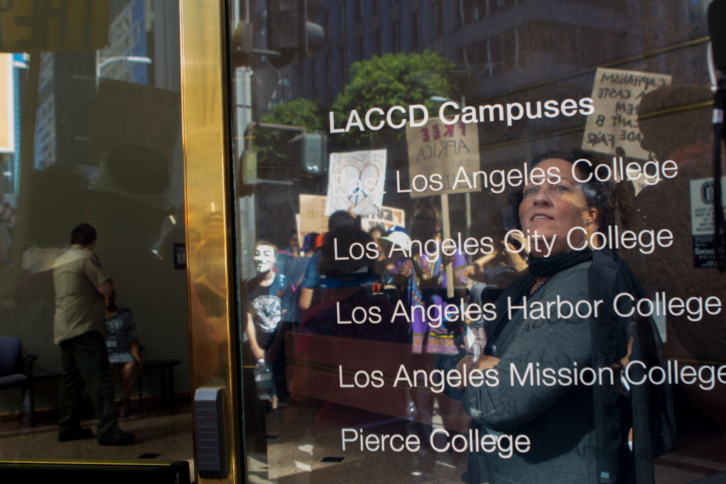 Some of the campuses that make up the large LA Community College District, reflected on a window in Los Angeles, Calif., Monday, October 1, 2012. Three positions on the Board of Trustees are up for votes this Tuesday.