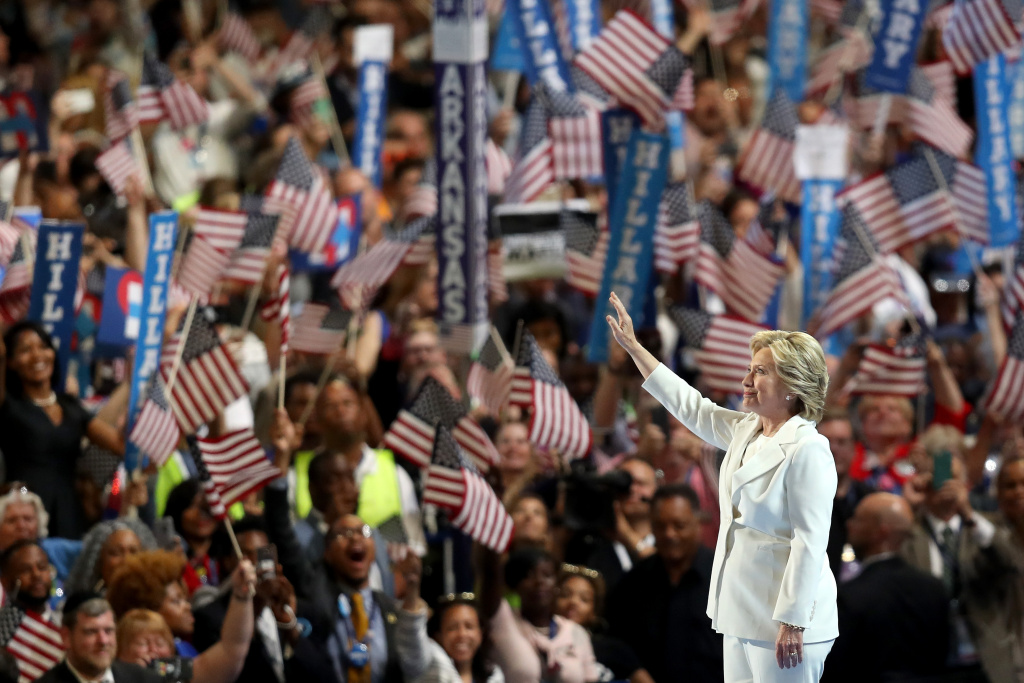 Democratic presidential candidate Hillary Clinton acknowledges the crowd as she arrives on stage during the fourth day of the Democratic National Convention at the Wells Fargo Center, July 28, 2016 in Philadelphia, Pennsylvania.