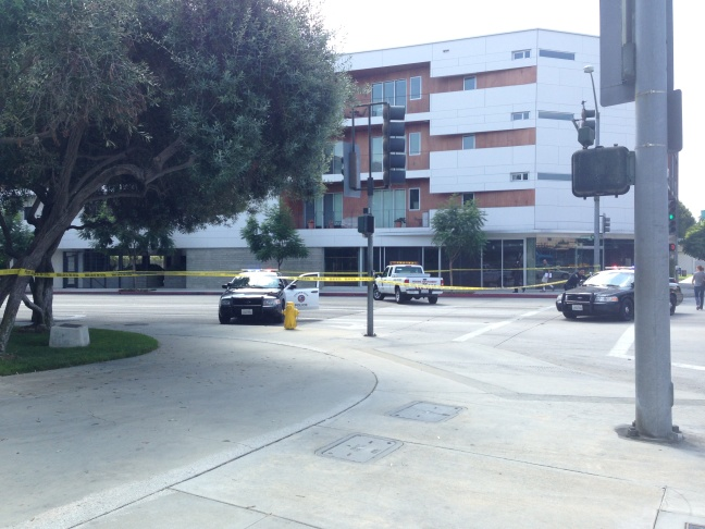 Police block off Duquesne Avenue near the Culver City police station following an officer-involved shooting at the station, Saturday, Sept. 21, 2013.
