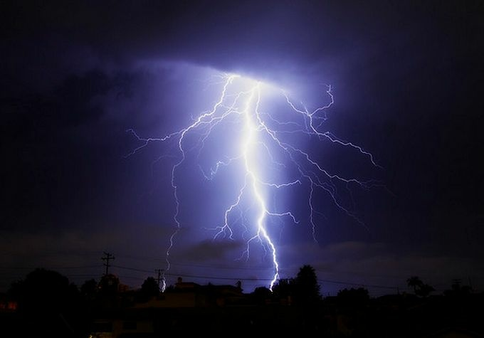 Lightning strike at Hermosa Beach, California. A 15-minute thunderstorm that hit Venice Beach Sunday left a 20-year-old man dead and four others injured by direct lightning strikes. .