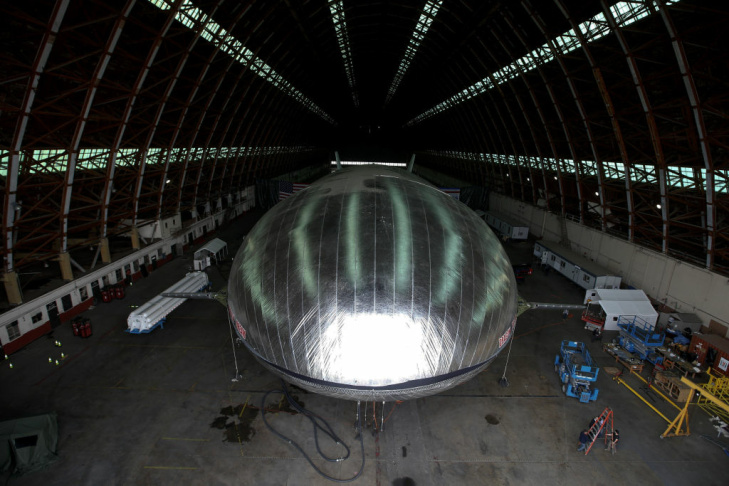 The Aeroscraft airship, a high-tech prototype airship, is seen in a World War II-era hangar in Tustin, Calif., Thursday, Jan. 24, 2013. Work is almost done on a 230-foot rigid airship inside a blimp hangar at a former military base in Orange Co. The huge cargo-carrying airship is has shiny aluminum skin and a rigid, 230-foot aluminum and carbon fiber skeleton.