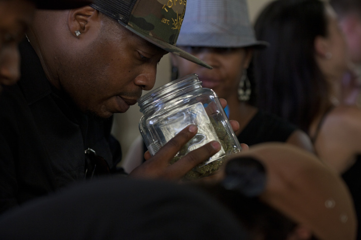 Touré Sudan of Gravity Massive and Tiger Foods prepares samples of cannabis-infused edible treats at the California Heritage Market, the first-ever medical marijuana farmers market in Boyle Heights.