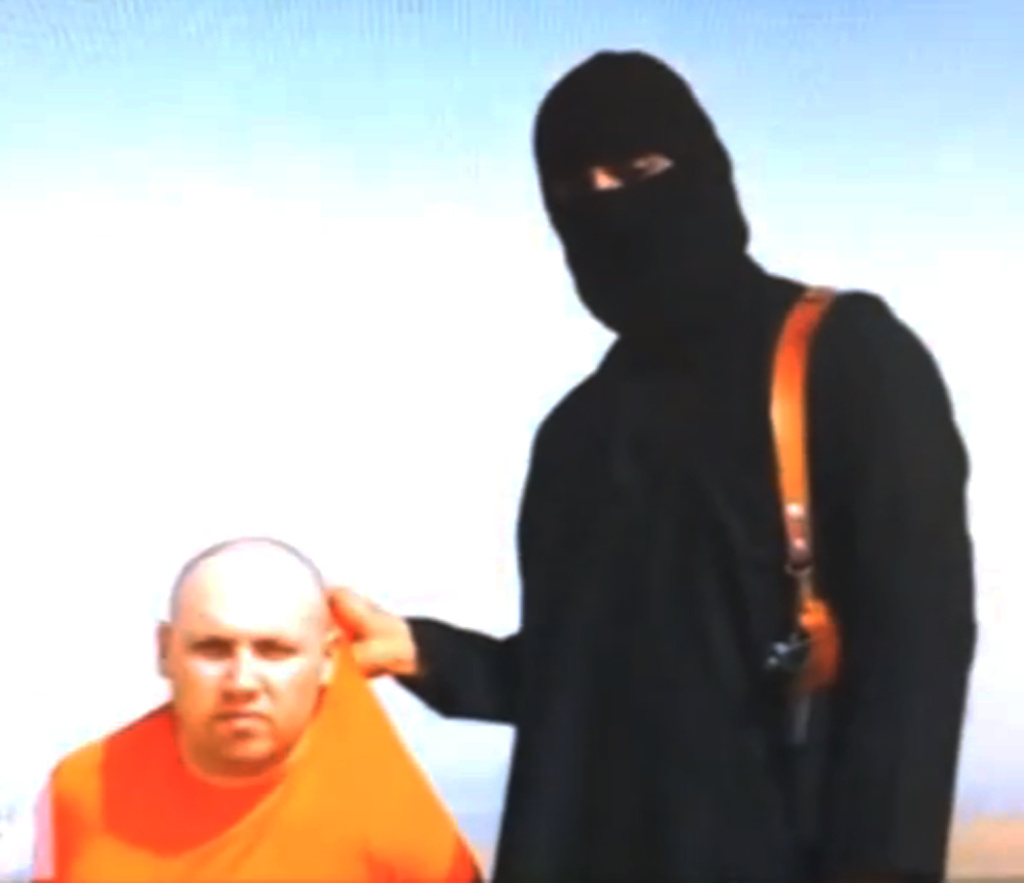 This still image from an undated video released by Islamic State militants on Tuesday, Aug. 19, 2014, purports to show journalist Steven Sotloff being held by the militant group. The US confirmed another video released Tuesday, Sept. 2, that shows Sotloff being beheaded by the group.
