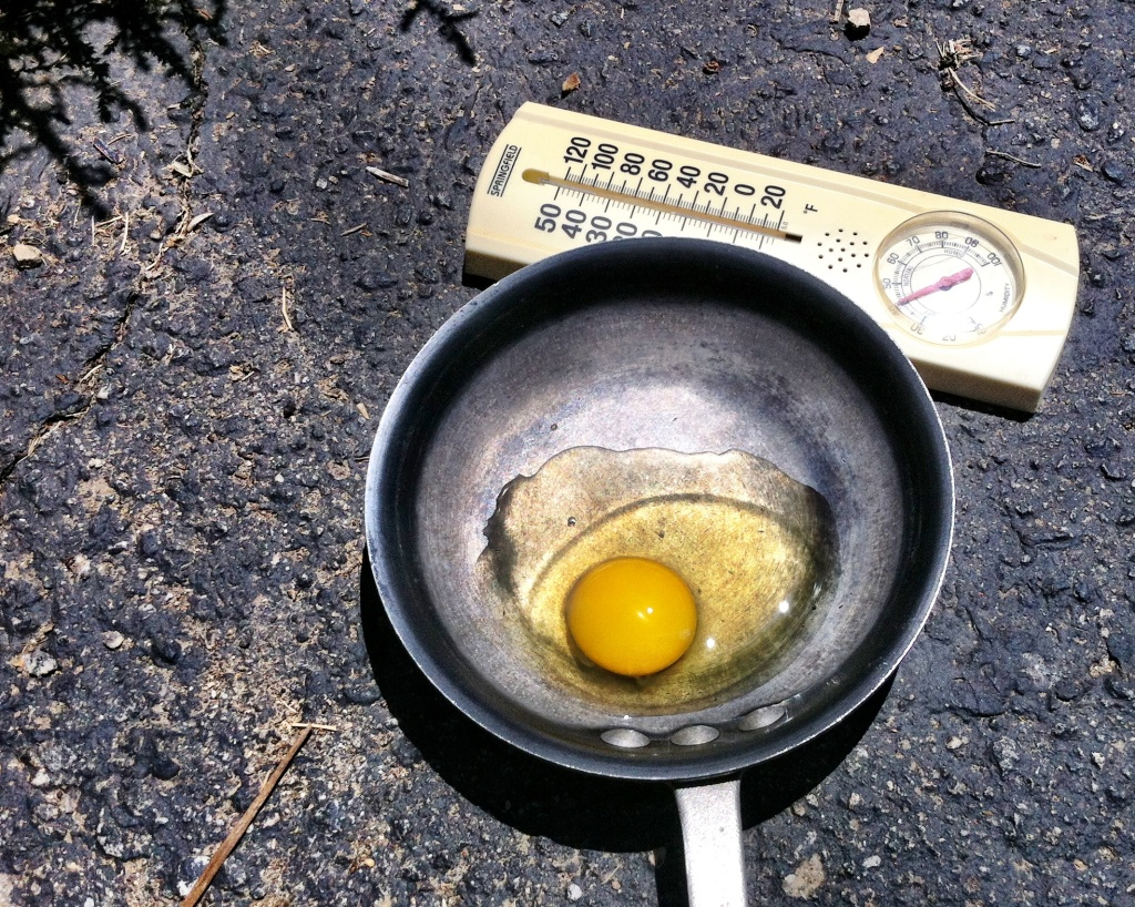 KPCC's John Rabe tries to fry an egg on the asphalt in Northridge where temperatures topped 100 degrees. You can hear if it worked this weekend on Off-Ramp.