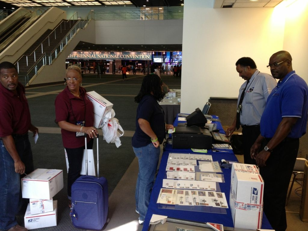Postal workers and union members lined up at the Los Angeles Convention Center to mail packages home. As the postal service moves to cut locations, jobs and hours, employees worry about their future — and the future of the service.