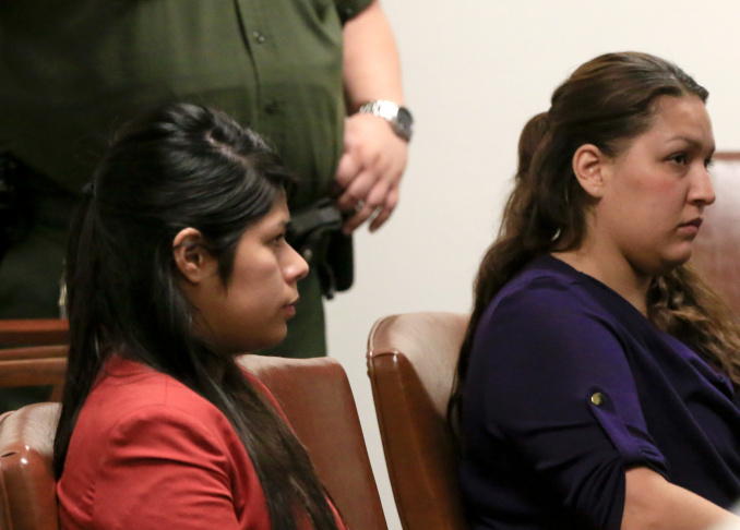 A preliminary hearing is underway for (left to right) Vanesa Zavala and Candace Marie Brito at the West Justice Center on February 10, 2014 in Westminster, California. The two defendants were moved from their chairs and placed in the jury box for a better viewing angle while the prosecution played a video allegedly implicating them in the beating death of Kim Pham in front of a Santa Ana nightclub.