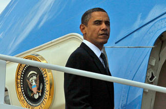 President Obama boards Air Force One at Andrews Air Force Base, Md., on Tuesday. Obama was headed to California for a fundraiser for Sen. Barbara Boxer.