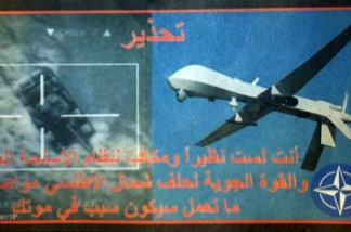 A reprodution of a leaflet dropped by NATO forces over the Libyan capital Tripoli. The leaflet reads in Arabic, ' Warning: You are not a match or equal to the superior weapons systems and airpower of NATO and pursuing your deed will lead to your death.'