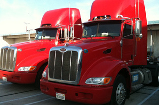 Trucks from the Ability-Tri Modal trucking company owned by Josh Owen