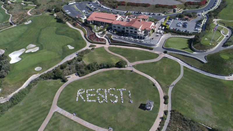 Two hundred members of Indivisible San Pedro form the word RESIST! Saturday at Trump National Golf Course in Rancho Palos Verdes.