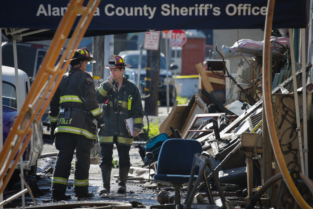 Firefighters work on the scene following an overnight fire that claimed the lives of at least nine people at a warehouse in the Fruitvale neighborhood on December 3, 2016 in Oakland, California. The warehouse was hosting an electronic music party.