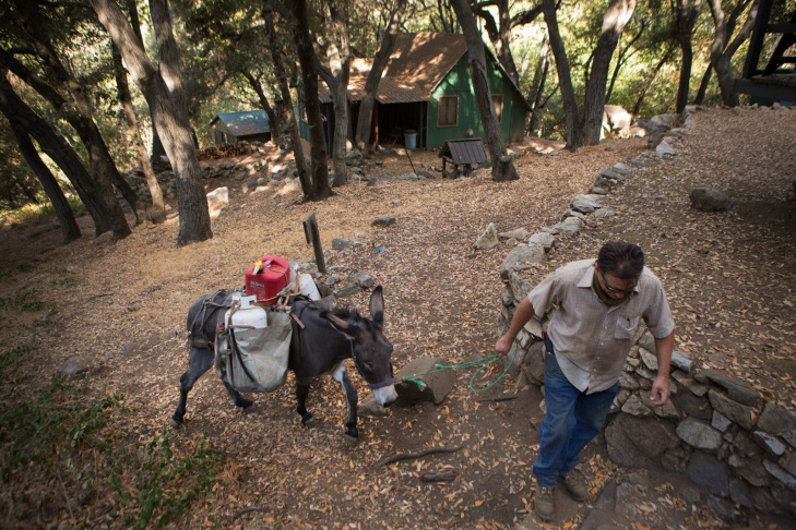 David Nickoloff brings propane and soap to a cabin owner in the Angeles National Forest.